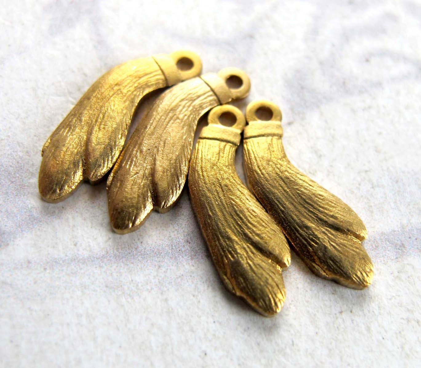 Brass Rabbits Foot Charms 4X M644-A by EpochBeads on Etsy