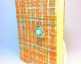Unique handmade Journal Notebook diary orange tweed fabric cover, lined paper, opens with vintage green button and white satin ribbon