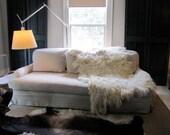 Natural cream color shaggy wool felt throw or rug
