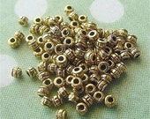 Tiny 2mm x 3mm Spacer Beads Gold Tone lead-free pewter lot of 100