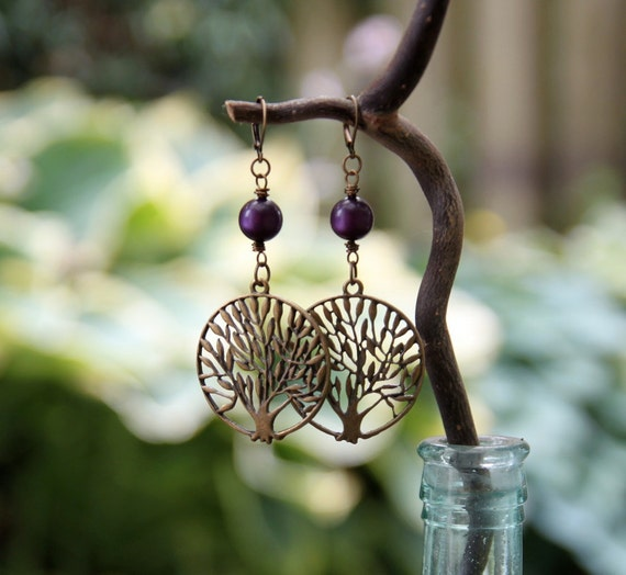 rooted earrings . deep purple