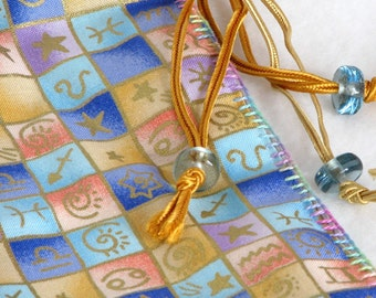 Hand stitched cotton drawstring bag, pastels, blue, pink, yellow, Sacred Symbols by melanie j cook
