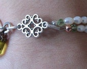 Pearl and Tibetan Silver bracelet with fold over clasp