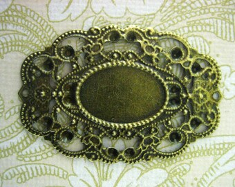 12  44x30mm filligree bezel setting, brass plated (holds a 13x18mm cabochon)