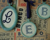 Monogram Cross Stitch Ornament in Glittery Frame (Letter E)