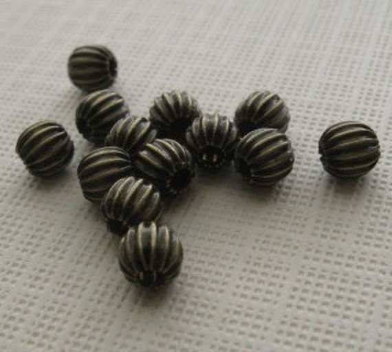 40 Antiqued brass 4mm corrugated round bead
