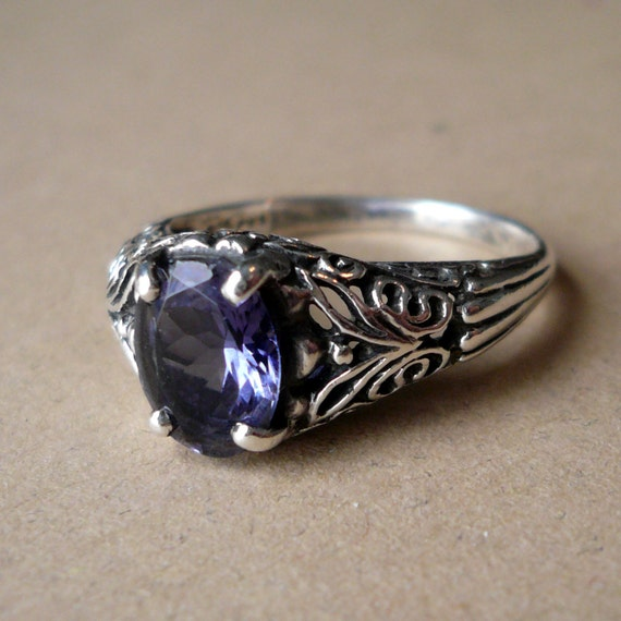 RESERVED Vintage sterling silver and tanzanite ring. Size 6.