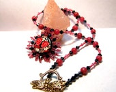 Pink roses and wildflower beaded pendant on gemstone and crystal necklace with dragonfly clasp