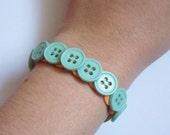 Button bracelet (light blue and orange)