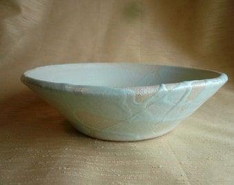 Shallow ceramic light blue fruit bowl