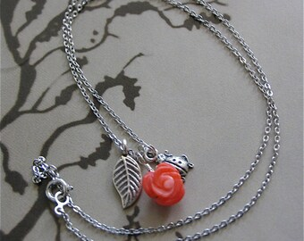 New Tiny Treasure Necklace with Coral rose carved, Lady bug and leaf charms