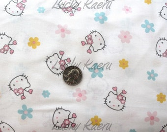 Hello Kitty Flowers and Faces White Multi Fabric - Half Yard