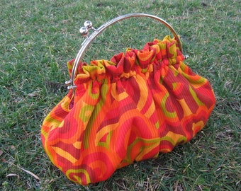 Purse in Swirls of Orange Red Yellow and Green with 8 Inch Frame