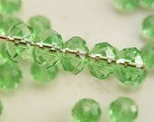 6x4mm Crystal Rondelles Faceted Beads Transparent Peridot Green (Qty 15) MW-6x4R-TPG