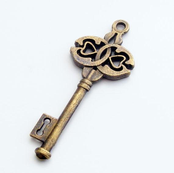 4 pcs Antique Brass Double Heart Skeleton Key Charm 44x17mm Z-N1206-AB