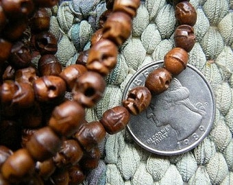108 bead wood skull bead mala 5x6mm
