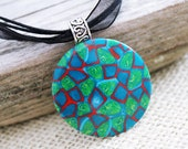 Polymer clay necklace. Custom sized four strand necklace. Polymer clay pendant. Green, turquoise blue, red.