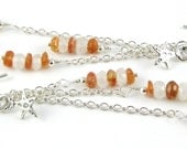Celestial sterling silver chain earrings featuring sunstone and moonstone and stars