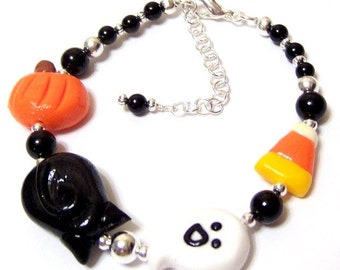 Happy Halloween Bracelet with polymer clay ghost black cat candy corn and pumpkin