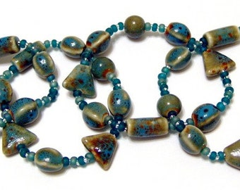 Pottery Bead Teal Blue Green Stretchy Bracelet Size LARGE 7 1/2 Inches