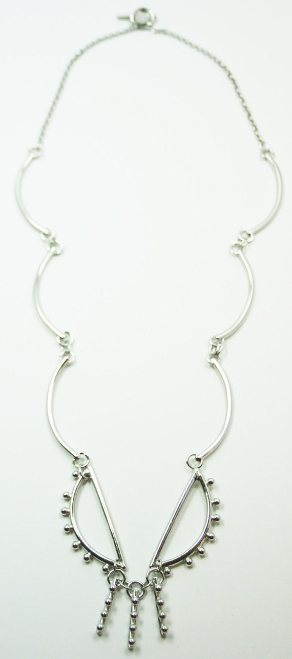 Long Curves Sculptural Silver Toned Necklace