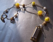 Tipitina Harmonica Necklace with vintage yellow glass beads