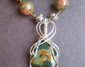 SALE originally 98.00  Wirewrapped Unakite pendant in sterling silver on a beaded necklace Colgan