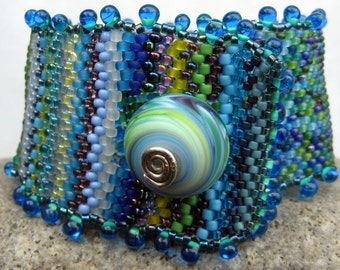 waterlilies, spring reflection cuff-- beadwoven bracelet in blues and greens-- handmade by thebeadedlily