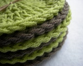 green and brown crochet coasters