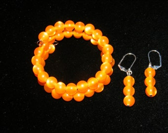 Orange wrap bracelet and matching earrings 1.00 to Breast Cancer research