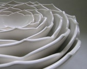 Eight Ceramic Nesting Lotus Bowls in White