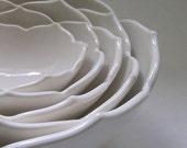 Five Nesting White Ceramic Lotus Bowls