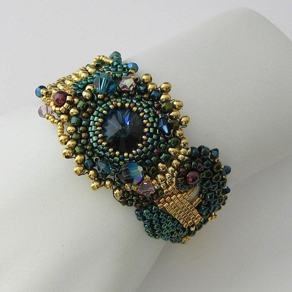 Freeform peyote bracelet, deep teal, burgandy and gold Montana Sapphire rivoli, beadwork bracelet