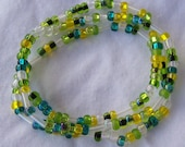 blue, green, and yellow stretch beaded bracelets