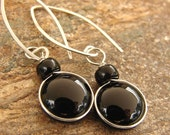 Black glass dangle earrings with sterling ear wires.