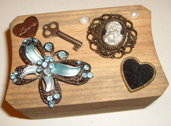 Memory box covered with vintage embellishments