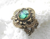 RESERVED - Celtic Rainforest Ring - Emerald Green Glass Opal and Antiqued Brass