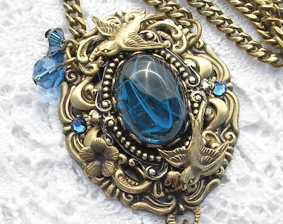 Sparrows Retreat Pendant - Vintage Blue Glass with Layered Brass Jewels and Birds
