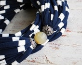 Navy blue and white stripes scarf necklace with a faceted natural stone by Sashetta