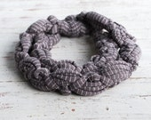 Braided necklace in grey jersey fabric