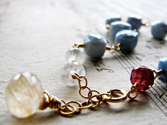 V A S T. S K Y.... Blue opals, garnet, moonstone on gold bracelet Ooak