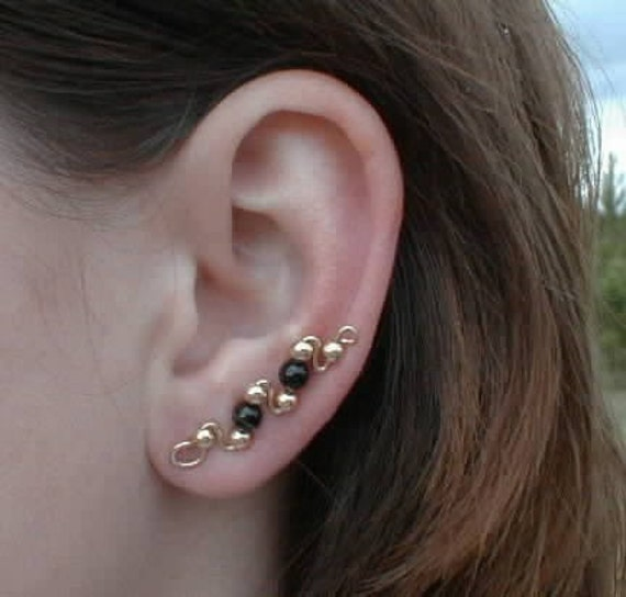 earrings that go up the earlobe climbing earring pin goes up your ear gold and onyx 4284