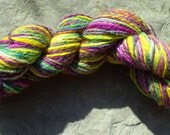 Handspun 3ply Falkland yarn in shades of green, pink, yellow and purple 102g