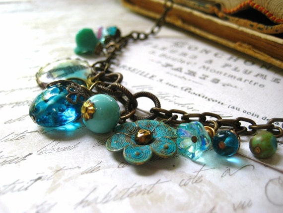 charm necklace brass vintage charms lampwork glass bead Eifel Tower cabochon turquoise teal womens jewelry