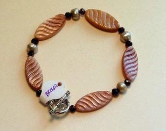 Pink shell bracelet with garnets