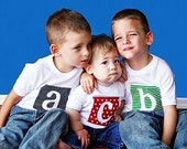 Personalised Siblings Initials  on white Tshirt. 5 fabrics in spots or stripes 0,2T,4T,6 and 8