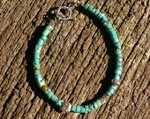 RESERVED Turquoise heishi bracelet with Thai Hilltribe and Bali Silver