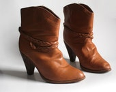 boots 6 or 6.5 shortie cowboy boots. shearling lined. wood heel. braided ankle wrap.