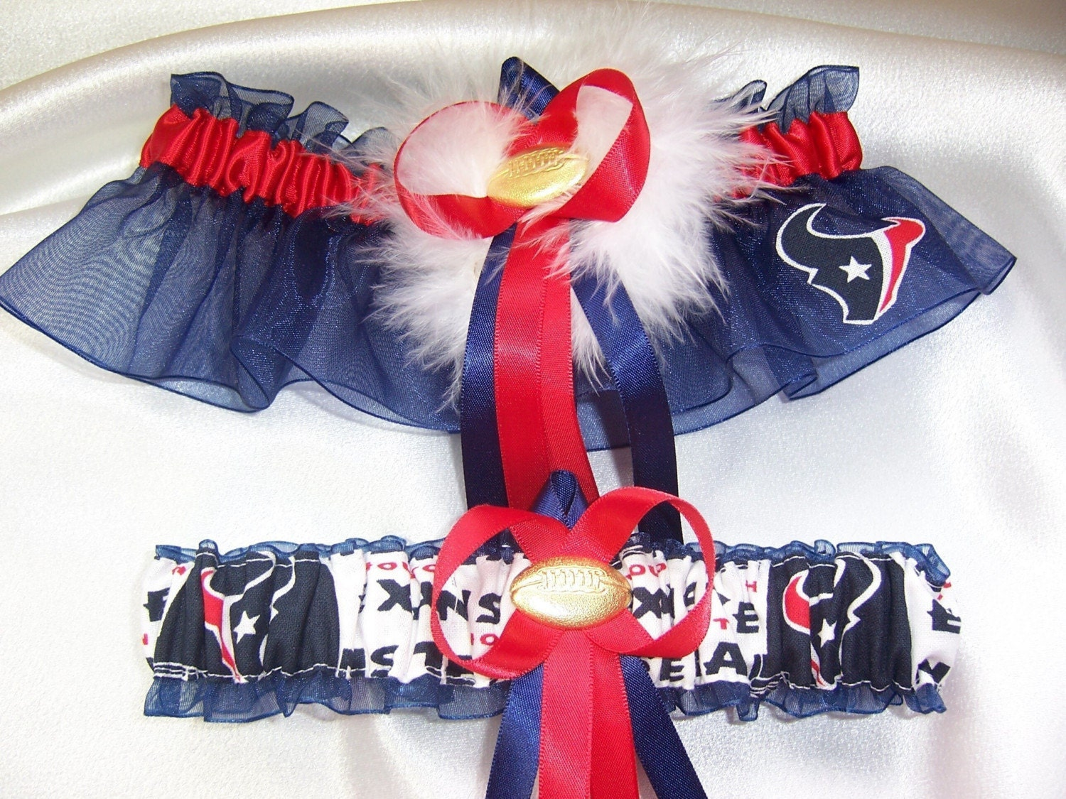 ... navy blue and red ribbons, a sexy marabou pouf, and a football charm.