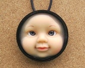 Cross-eyed  Upcycled Doll Face Pendant